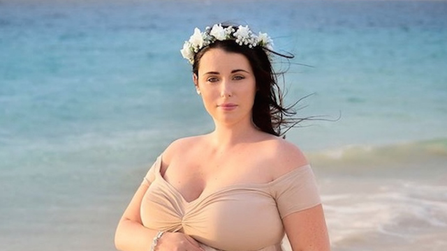 Woman pregnant with quintuplets looks beautiful but uncomfortable in photo shoot.