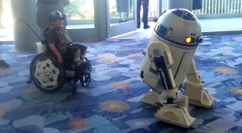 R2-D2 playing with a kid in a wheelchair is the sweetest thing ever.