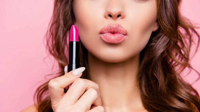 Radio host compares women wearing lipstick at work to men wearing a 'giant artificial boner.'