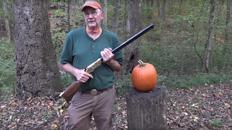 True American carves his pumpkin by shooting it with a rifle.