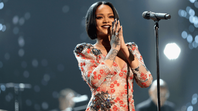 Rihanna hands mic to audience member, actually says 'whoa' when she hears him sing.