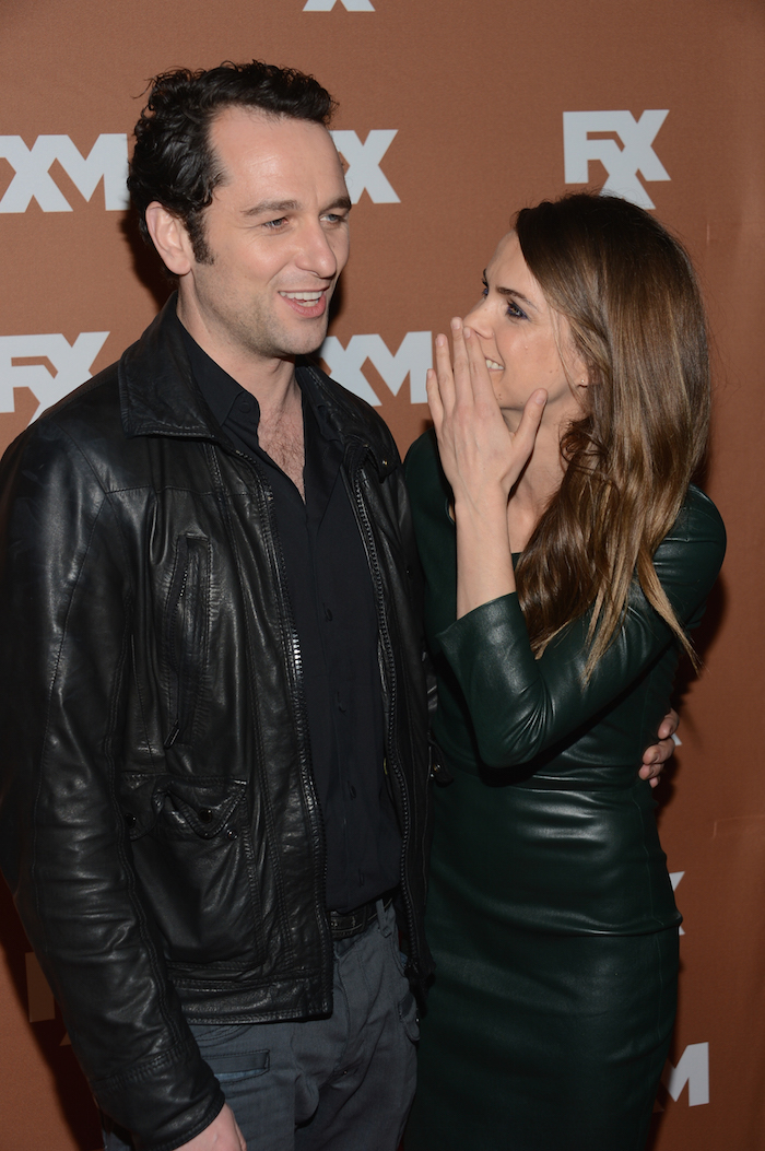 Matthew Rhys & Keri Russell look like they're hatching a plan at a 2013 FX event.
