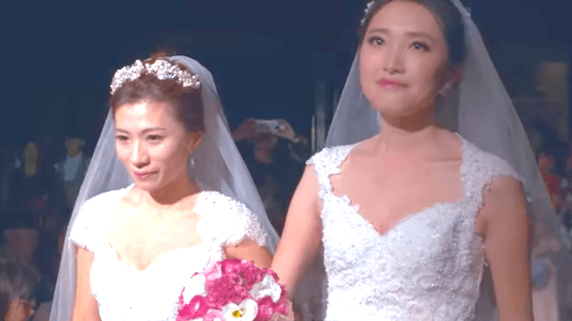Woman's boss walks her down the aisle when her father boycotts her same-sex wedding.