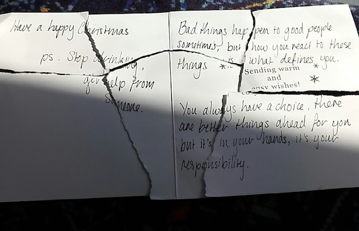 Someone found a ripped-up Christmas card and reassembled it to read a poignant message.