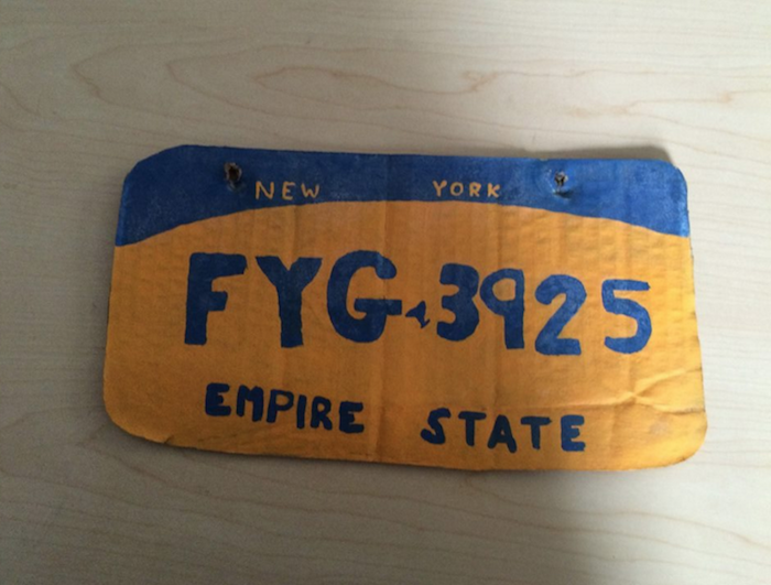 Question: what could make this cardboard license plate less convincing?
