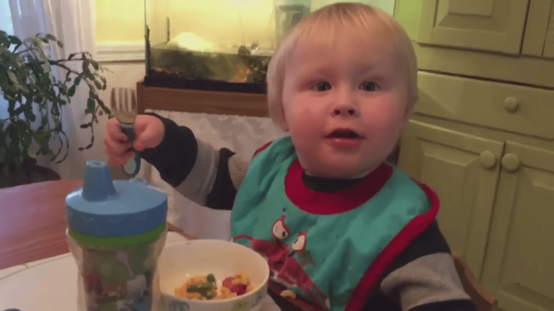 This frustrated baby is unable to find the fork that's right there in his hand.