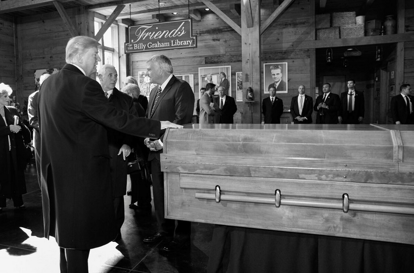 The internet noticed something puzzling about Trump's tweet at Billy Graham's funeral.