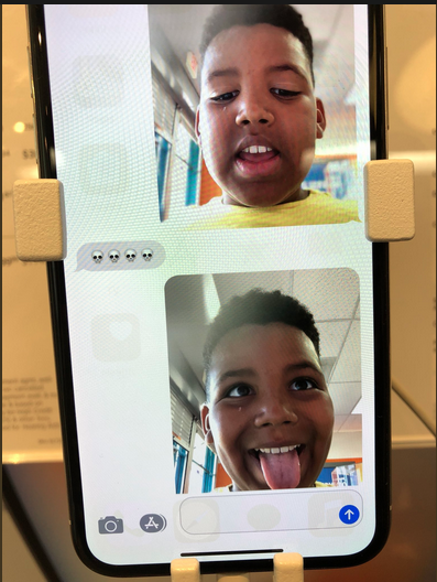 Hilarious little kid pranks stranger from AT&T store display phone, becomes internet hero.