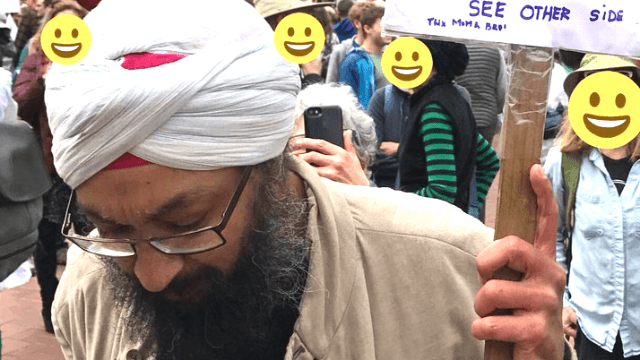 Sikh man takes on airplane prejudice with the ultimate protest sign.