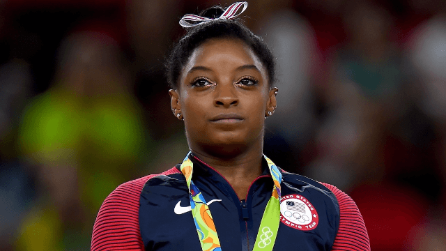 Simone Biles shuts down Instagram follower who called her a bad role model.