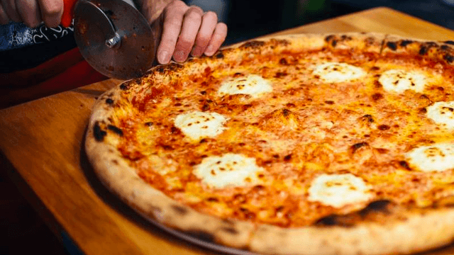 At long last, someone made a pizza topped with more than 100 kinds of cheese.