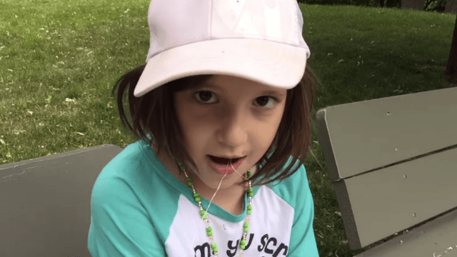 Little girl gets her loose tooth removed by a squirrel, and her dad is absolutely thrilled.