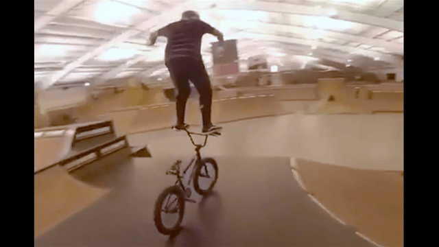 If you watch one crazy human trick this week, make it this dude surfing on a BMX bike's handlebars.