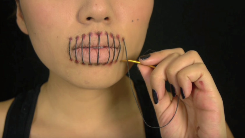 Horrify everyone you know with this stitched-lip Halloween makeup tutorial.