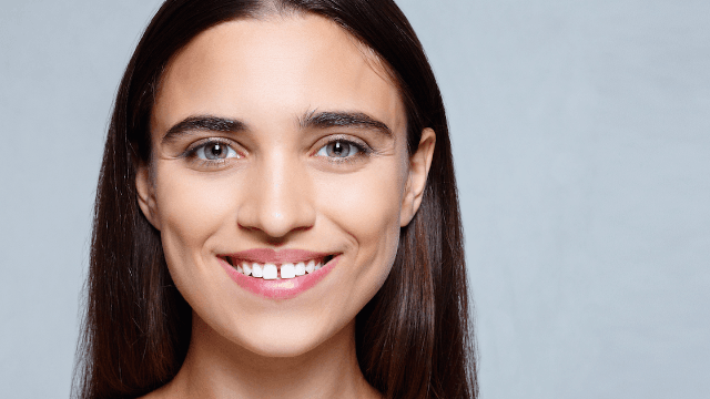 Model hits back at random troll who tried to make a meme out of her smile.