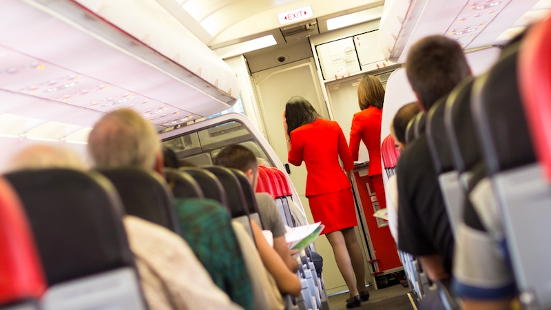 Plane crew almost lets man die because they refuse to believe black woman is a doctor.