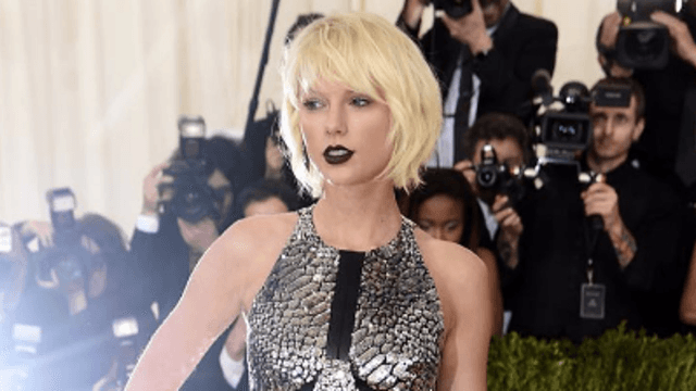 Of course Taylor Swift posted an Instagram of her post-Met Gala animal-onesie pizza party.