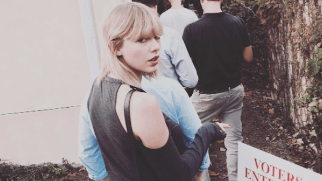 Taylor Swift's sweater may reveal who she voted for.