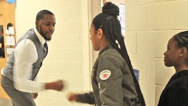 World's coolest teacher has the best way of greeting students.