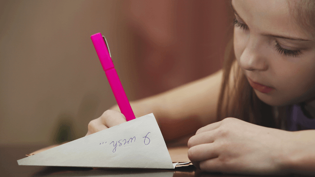 Social media erupts over teacher's stern 'warning' to little girl who wrote her name in cursive.