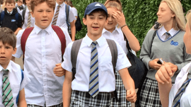 Teenage boys wear skirts to school to protest the no shorts dress code.