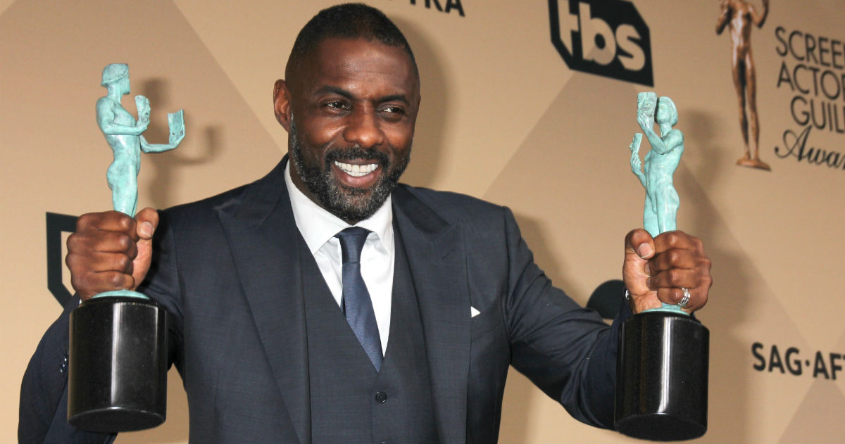 """Feast your weary eyes on these 15 photos of """"The Sexiest Man Alive,"""" Idris Elba. You're welcome."""