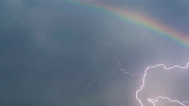 This viral photo of lightning and a rainbow is too cool, so let's start a rumor it was photoshopped.