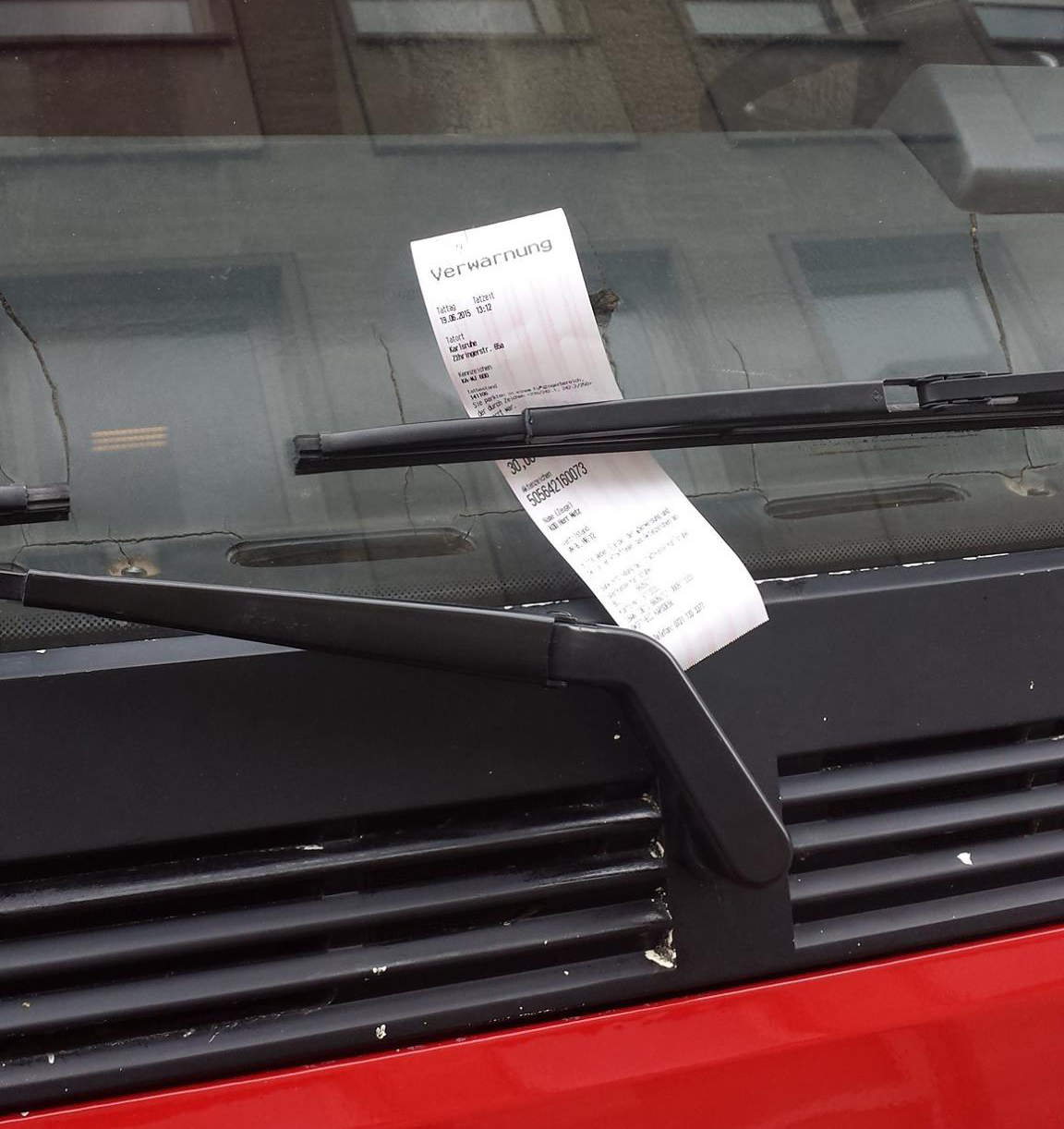 Cop issues parking ticket to a statue.