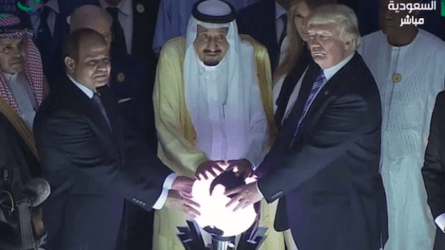 Trump touching a creepy glowing orb with Egyptian and Saudi leaders is all you could want in a meme.