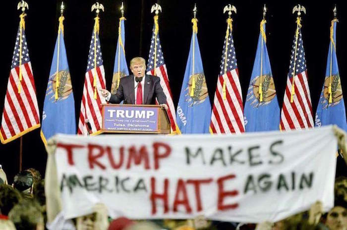 Teens snuck this awesome banner into a Trump rally before getting kicked out.