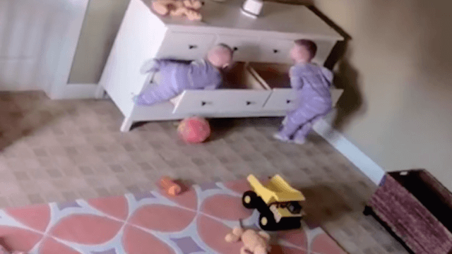 Viral video shows quick-thinking 2-year-old rescue his twin from precarious situation.