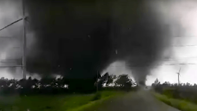 Curious Germans get very close to twin tornadoes before the novelty finally wears off.