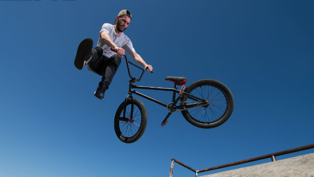 Twitter can't stop watching this BMX rider nearly impale himself on a gate.