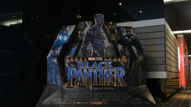 Two guys stacked in a trench coat tried to get into #BlackPanther. There's video footage.