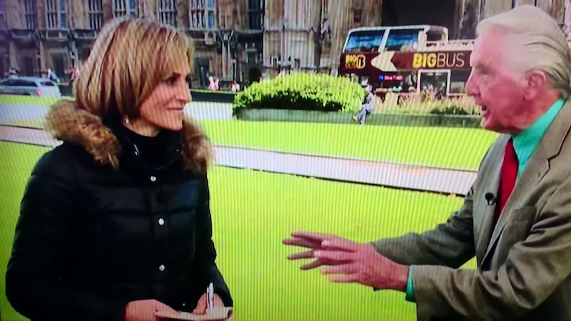 Angry politician heckles his own TV news interview.