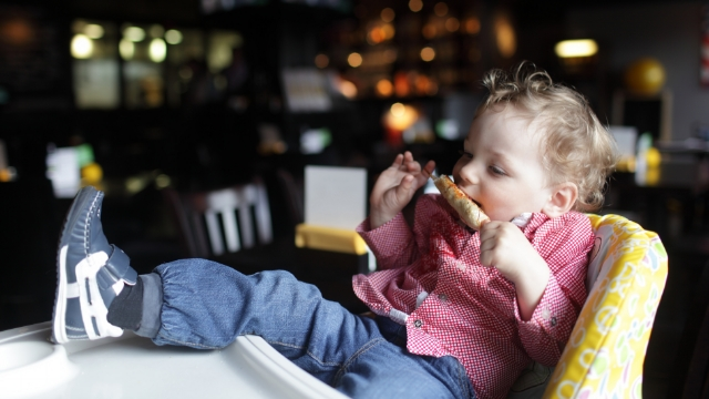 Woman asks if it's okay to un-invite family with toddler to expensive dinner.