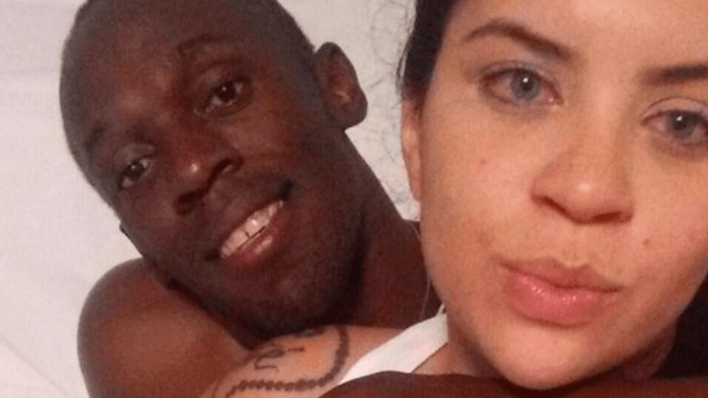 Usain Bolt was photographed in bed by a woman who is not his girlfriend.
