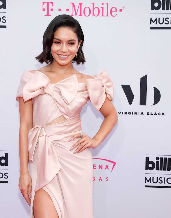 Leave it to Hudgens to make giant satin pink bows look fashionable.