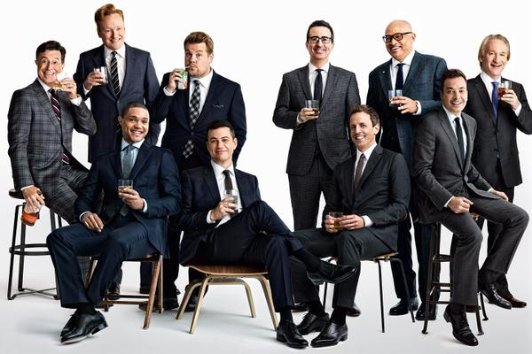Some happy, funny men in dress shoes.