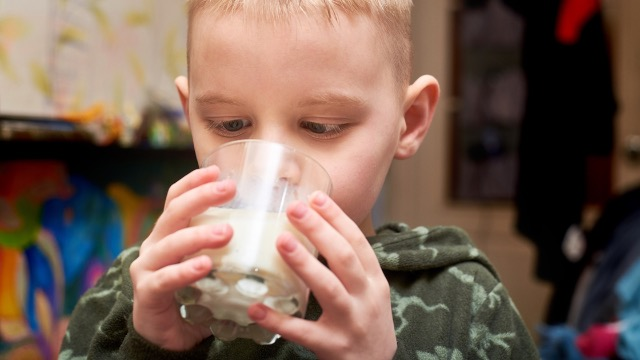 Mom asks if she was wrong to not pay babysitter who gave vegan son milk, causing allergic reaction.