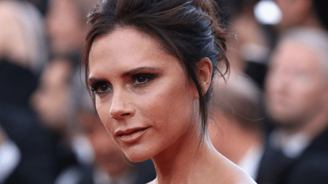 Victoria Beckham strutted her stuff in Times Square and got freaky with Cookie Monster disco-style.