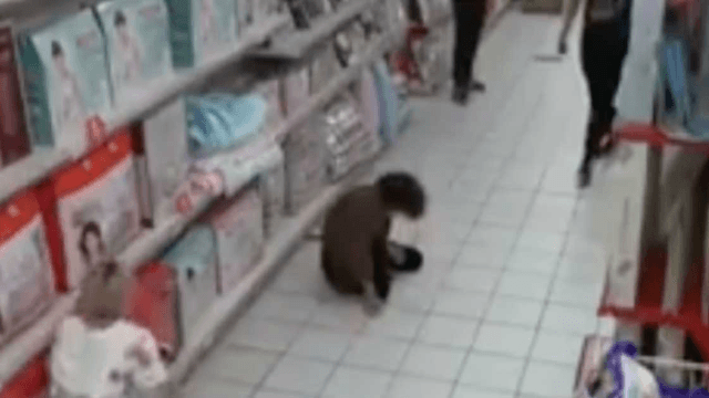 This viral security footage of a 'possessed' woman in China is straight out of a horror movie.