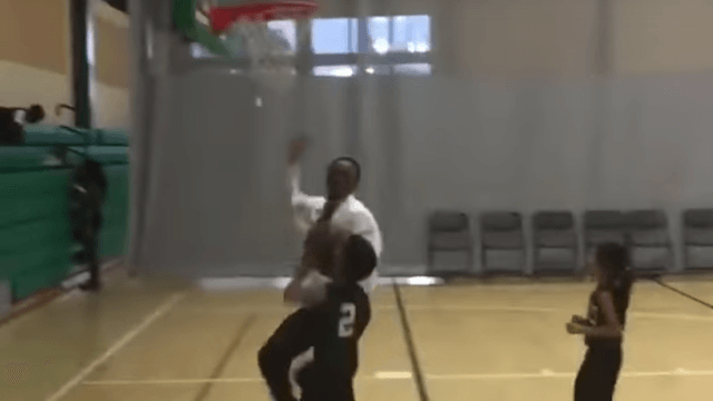 Watch this basketball coach brutally deny a little kid's shot for a very good reason.