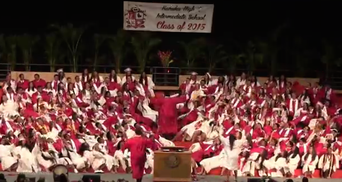 High school seniors perform over-the-top awesome song-and-dance number at graduation.
