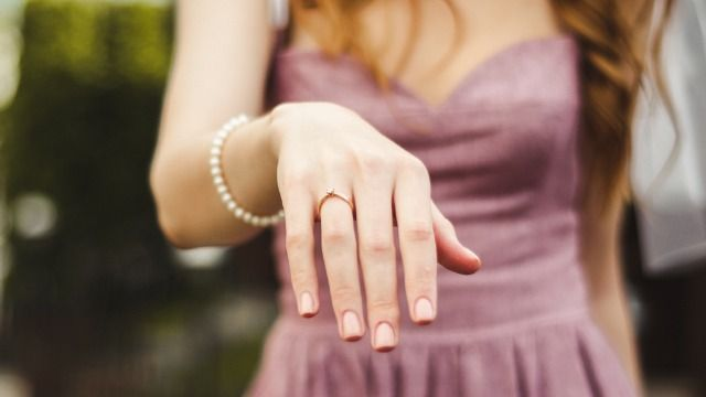 Woman asks if she's wrong for 'accidentally' announcing her engagement at her friend's wedding.