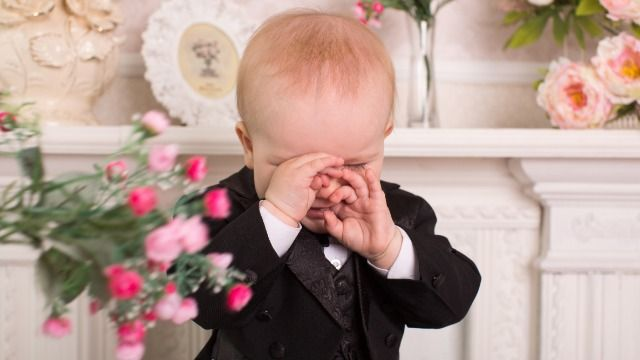 Bride asks if she's wrong for booting family from wedding after kid cried during vows