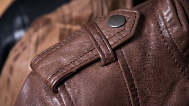 Woman discovers what the shoulder button on jackets is for and everyone's minds are blown.