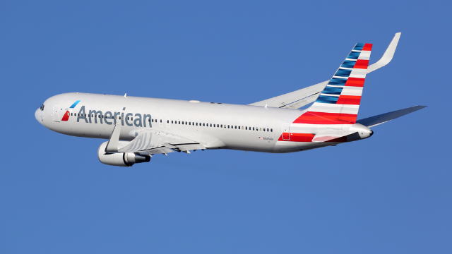 Plane passenger slinging racial slurs throws laptop at boyfriend for 'looking at other women.'