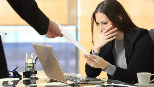 Woman who works for fiancé asks if she was wrong to tell him to fire her co-worker for lateness.