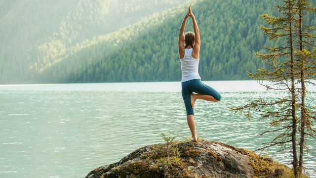 Watching this woman fall into a river while doing yoga is more relaxing than yoga.